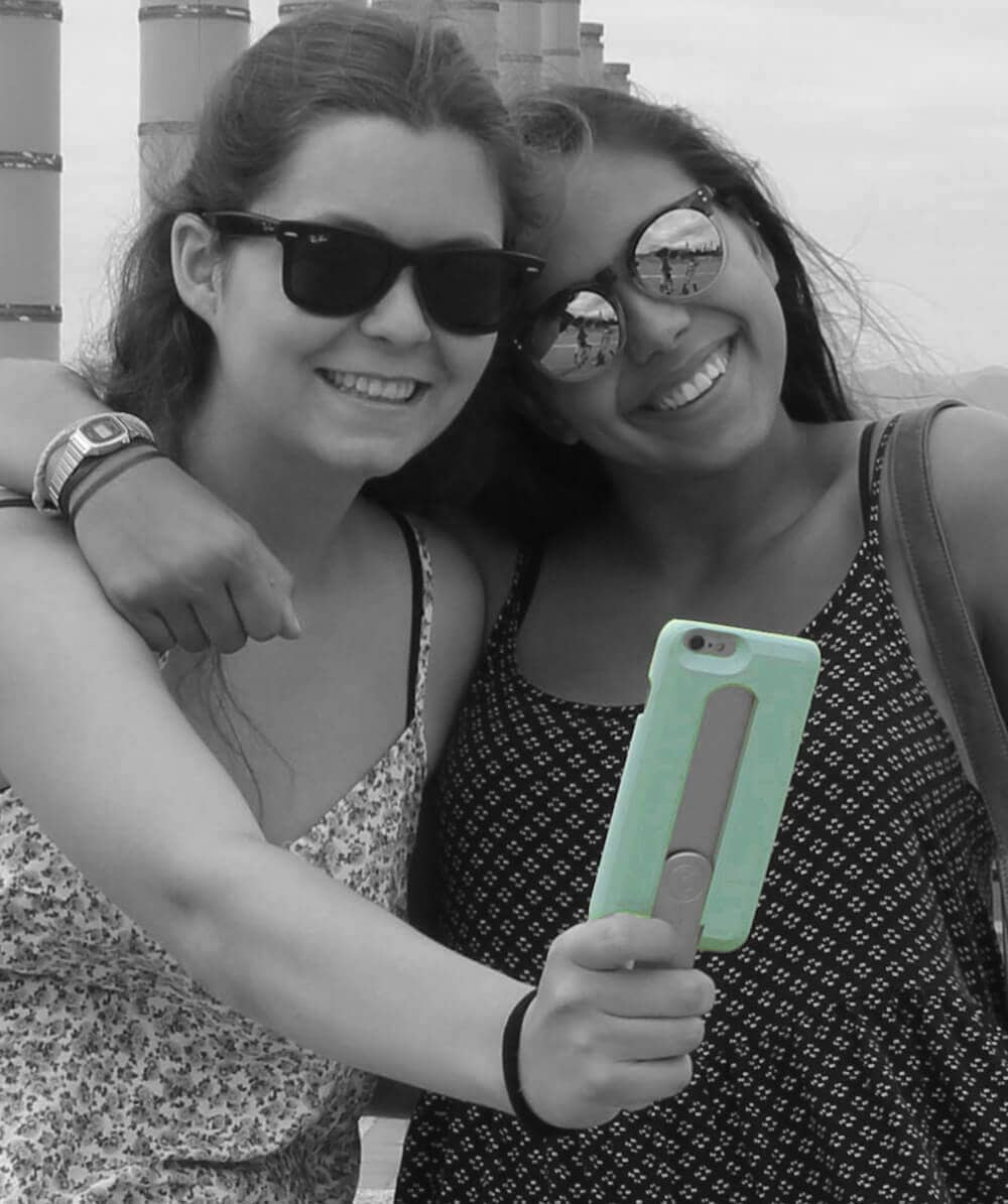 girls taking a selfie with a stick